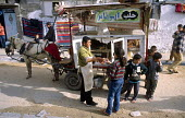 Travelling sweets seller in Shati / Beach refugee camp, Gaza 2003 - Howard Davies - 2000s,2003,and,arab,arabs,bank,BANKS,Beach,BEACHES,business,buy,buyer,buyers,buying,camp,camps,CHILD,CHILDHOOD,children,COAST,coastal,coasts,commodities,commodity,conflict,conflicts,Diaspora,displaced