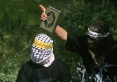Palestinian militants with copy of the Koran training for military action against Israeli forces Gaza. 2003 - Howard Davies - 01-07-2003