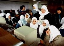 Palestinian refugee women learning IT skills at UNRWA training project. Ramallah, West Bank. 1992 - Howard Davies - 01-07-1992