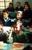 Palestinian refugee children studying at an UNRWA school, Gaza.. 1993 - Howard Davies - 01-07-1993