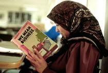 Palestinian refugee woman learning business skills at UNRWA training project. Gaza. 1993 - Howard Davies - 01-07-1993