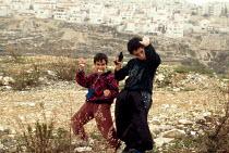 Israeli settler children celebrate Purim festival at Gilo settlement on the Palestinian West Bank. 1993 - Howard Davies - 01-07-1993