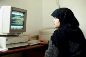 Palestinian woman working in Arabic on a computer at a research project on the West Bank. 1993 - Howard Davies - 01-07-1993