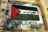 Palestinian flag on a wall in a refugee camp in Gaza. 1993 - Howard Davies - 01-07-1993