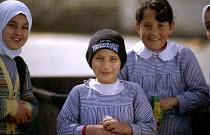Palestinian school children at an UNRWA primary School, within the Al-Shati refugee camp. - Howard Davies - (UNRWA),2000s,2003,Agency,and,arab,arabs,bank,BANKS,Beach,BEACHES,camp,camps,child,CHILDHOOD,children,COAST,coastal,coasts,Diaspora,displaced,dress,eat,eating,edu education,education,educational,EMOTI