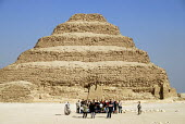 Tourists being photographed at the Step Pyramid at Saqqara outside Cairo, Egypt. 2006 - Howard Davies - 07-11-2006