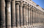 Colonnade at the Temple of Isis, on the Island of Philae. - Howard Davies - 2000s,2005,Abjad,ACE,ace arts culture,african,Africans,Ancient,arab,arabic,arabs,attraction,attractions,BUILDING,BUILDINGS,carve,carved,carving,carvings,character,characters,colonnade,column,columns,c