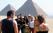 Tourists pose for photographs at the Pyramids of Giza, Cairo, Egypt 2005 - Howard Davies - 14-10-2005