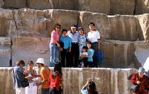 Tourists posing for photographs, at the Pyramids of Giza. - Howard Davies - 14-10-2005