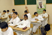 Saudi school children in class at a private school in Jeddah with a photograph of King Abdullah on the wall. Saudi Arabia 2006 - Howard Davies - 26-09-2006