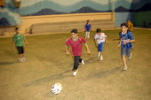 Saudi school children playing football in the evening to avoid the heat, Jeddah. Saudi Arabia 2006 - Howard Davies - 2000s,2006,arab,arabs,boy,boys,child,CHILDHOOD,children,edu education,education,evening,football,game,games,islam,islamic,juvenile,juveniles,kid,kids,male,middle east,monotheistic,MUSLEM,muslim,muslim