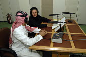 Woman radio presenter, Saudi national radio. Jeddah, Saudi Arabia 2006 - Howard Davies - 25-09-2006