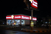 Fast food outlet, Jeddah, Saudi Arabia - Howard Davies - 2000s,2006,ACE,arab,arabs,architecture,building,buildings,cities,city,consumerism,culture,drive-through,EBF Economy,fast,fast food,fast food,fastfood,fast-food,food,foods,highway,junk food,light,light