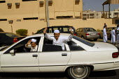 Young Saudi men driving around Jeddah, Saudi Arabia 2006 - Howard Davies - 2000s,2006,arab,arabs,AUTO,AUTOMOBILE,AUTOMOBILES,AUTOMOTIVE,car,cars,cities,city,consumerism,DRIVER,DRIVERS,driving,EBF Economy,Jedda,Jeddah,jeddans,Jidda,Jiddah,LFL Leisure,male,man,men,Middle East,
