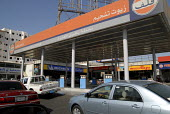 Petrol station in Saudi Arabia where fuel is very cheap due to large subsidies from the Government. Saudi Arabia 2006 - Howard Davies - 2000s,2006,arab,arabs,AUTO,AUTOMOBILE,AUTOMOBILES,AUTOMOTIVE,car,cars,cities,city,diesel,EBF Economy,energy,filling station,fuel,fuels,infrastructure,middle east,oil,Oil Industry,petrochemical,petrol,