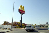 McDonalds fast food outlet in Riyadh, Saudi Arabia - Howard Davies - 2000s,2006,Americanisation,arab,arabs,AUTO,AUTOMOBILE,AUTOMOBILES,AUTOMOTIVE,Big Mac,CAPITALISM,capitalist,car,cars,catering,cities,city,consumerism,Corporation,drive through,EBF,Economic,Economy,fast