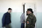 Mongolia, a young offender emerges from the rows of cells Juvenile pretrial detention Centre. Looking like a prison unit and part of the adult prison complex, young minor offenders often end up incarc... - 24-04-2007