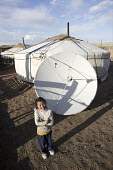 Oyunbat, 10 yrs in front of their ger tent with a satellite receiving dish for receiving television transmissions. Public information communications in Mongolia is made easier by widespread dish use.... - 25-04-2007