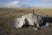Ger tent with a satellite receiving dish for receiving television transmissions in the middle of the Mongolian plateaue. Public information communications in Mongolia is made easier by widespread dish... - 25-04-2007