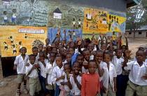 Children in front of school mural in rural Uganda. Uganda. 1998 - Jim Holmes - 03-07-1998