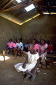 Children at a rural school with no desks or proper chairs. Uganda. 1998 - Jim Holmes - 03-07-1998