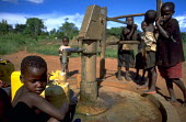 Children collect water at an NGO provided pump near Masaka. Uganda. 1998 The provision of clean drinking water prevents water borne disease. - Jim Holmes - 03-07-1998