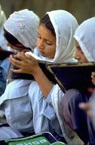 Muslim scholgirls studying in northern Pakistan. Pakistan. 1997 - Jim Holmes - 03-07-1997
