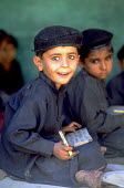 A schoolboy in his class.. Pakistan. 1997 - Jim Holmes - 03-07-1997