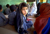 A young Muslim girl at school in northern Pakistan. Pakistan. 1998 - Jim Holmes - 03-07-1998