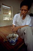 Drug addict in a rehab centre in Hanoi. Vietnam. 1999 - Jim Holmes - 03-07-1999