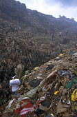 All ages work sort through the vast mountains of rubbish on the civic dump on the edge of Manila. Philippines. - Jim Holmes - 03-07-2001
