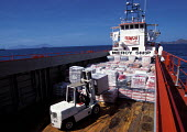 The first aid arriving by ship for people affected by the conflict in Dili, East Timor. 1999 - Jim Holmes - 1990s,1999,ARRIVAL,arrivals,arrive,arrived,arrives,arriving,asia,asian,asians,boat,boats,conflict,developing,East Timor,EBF,Economic,Economy,Food Aid,marine,maritime,maritime industry,nations,nautical