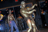 Bodybuilder show at a nightclub in Vientiane. Laos 2001 - Jim Holmes - 03-07-2001