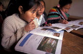 NGOs produce curriculum books that discuss the problems and dangers of playing with unexploded bombs and landmines, most of which were left by the US after massive ariel bombardments. Near Luang Praba... - Jim Holmes - 03-07-2001