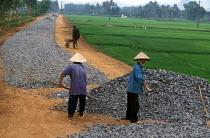 Vietnamese workers construct rural roads in Danang Province. Vietnam 2001 - Jim Holmes - 03-07-2001