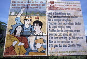 Vietnamese poster illustrating the benefits and successes of socialism. Vietnam 2001 - Jim Holmes - 03-07-2001
