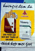 Advertisement for a local brand of cigarettes. Tobacco is very cheap in Vietnam and many Vietnamese men are heavy smokers. Vietnam. - Jim Holmes - 03-07-2001