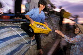 Sea fish being unloaded from trawlers in the port of Vinh Long in the Mekong Delta. Vietnam 2001 - Jim Holmes - 03-07-2001