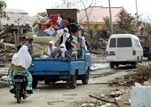 Tsunami survivors gather their belongings having survived the earthquake and Tsunami. Aceh, Indonesia 2005 - Jim Holmes - 03-04-2005