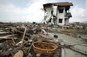 After the Tsunami areas of Banda Aceh closer to the sea saw almost total destruction, where most buildings were more simply constructed of cheaper materials. The wooden flotsam came from homes of poor... - Jim Holmes - 03-04-2005