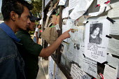 Following the Tsunami printed leaflets show pictures of lost or missing people from relatives who have come to search for them. At TVRI, a local TV station compound IDP camp, IDPs are assisted to trac... - Jim Holmes - 03-04-2005