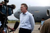 British minister for overseas development, Hilary Benn MP, accompanies first C17 transport plane into Banda Aceh. Aceh, Indonesia 2005 - Jim Holmes - 03-04-2005
