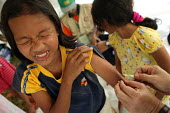 After the Tsunami a child being vaccinated against measles at an IDP camp in a government building in the centre of Banda Aceh by volunteer doctors from other provinces of Indonesia. Aceh, Indonesia 2... - Jim Holmes - 03-04-2005