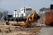 Huge coal carrying barge stranded with its tug some hundreds of meters from the sea after the tsunami wave lifted it up and took it ashore. Aceh, Indonesia - Jim Holmes - 25-04-2005