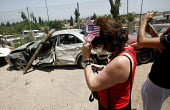 Quiriat Shemona. Israel. Christians From America vistit the Border town of Quiriat Shemona and vistit an exhibition put on by the towns police of cars hit by rockets and the rockets themselves fired b... - Thomas Morley - 04-07-2006