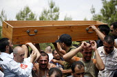 Funeral in Arab Al Aramshe, Israel Lebanon border. The Jomaa family, Arab Israeli , were sitting in front of their house when a rocket fired by Hezbollah landed close by. In the blast the two daughter... - Thomas Morley - 06-08-2006