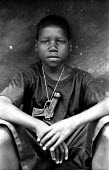 Acholi child in an IDP camp for Acholi displaced by the violent conflict waged between the Ugandan Government army - UPDF - and the Lords Resistance Army in northern Uganda for 20 years. More than 1.5... - Thomas Morley - 05-03-2005
