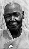 An elderly Acholi woman living in an IDP camp for Acholi displaced by the violent conflict waged between the Ugandan Government army - UPDF - and the Lords Resistance Army in northern Uganda for 20 ye... - Thomas Morley - 05-03-2005