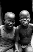 Acholi children in an IDP camp for Acholi displaced by the violent conflict waged between the Ugandan Government army - UPDF - and the Lords Resistance Army in northern Uganda for 20 years. More than... - Thomas Morley - 05-03-2005