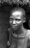 An Acholi woman living in an IDP camp for Acholi displaced by the violent conflict waged between the Ugandan Government army - UPDF - and the Lords Resistance Army in northern Uganda for 20 years. Mor... - Thomas Morley - 05-03-2005